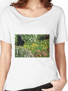 Many beautiful colorful flowers in the park. Women's Relaxed Fit T-Shirt