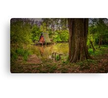 Cottage on the water in spring Canvas Print
