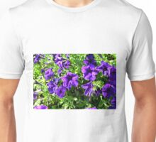 Purple flowers and green leaves natural background. Unisex T-Shirt