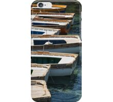 Traditional wooden fishing-boats. iPhone Case/Skin
