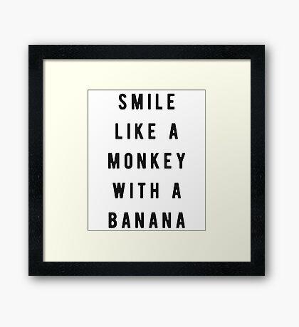 Smile like a monkey with a banana Framed Print