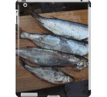raw fish on a cutting table iPad Case/Skin