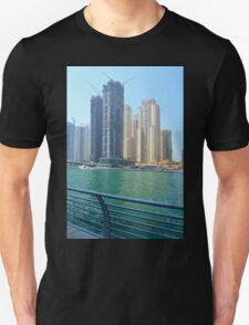 Photography of many tall buildings, skyscrapers skyline seen from the water from Dubai. United Arab Emirates. T-Shirt