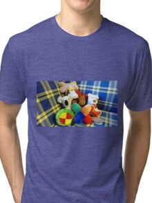 Eddie's Toys - sit on settee in Family room Tri-blend T-Shirt