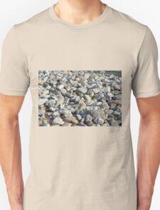 Pebbles at the sea shore. T-Shirt