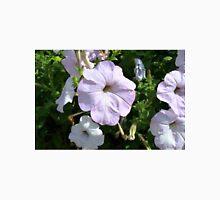 Beautiful light purple flowers in the park. Unisex T-Shirt