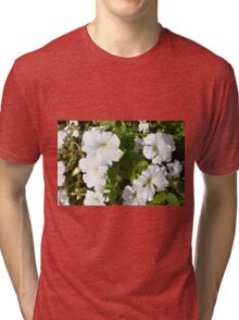 White flowers in the green bush. Tri-blend T-Shirt