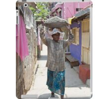 A lady labourer carrying cement on her head in Cochin India iPad Case/Skin