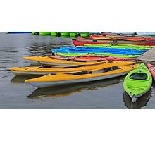 Tied up Kayaks on water Photographic Print