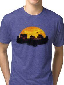 Sunset over city skyline - Birds Tri-blend T-Shirt