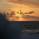 Sunrise and Sea Spray by EzekielR
