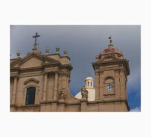 A Well Placed Ray of Sunshine - Noto Cathedral Saint Nicholas of Myra Against a Cloudy Sky One Piece - Long Sleeve