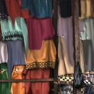 Flowing Colors in a African Market by Wayne King