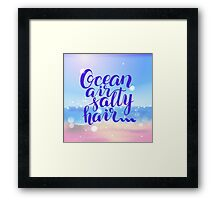 Surf lettering  Ocean air salty hair on a  defocus blurred summer background Framed Print