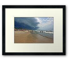 Storm clouds of an tropical hurricane bringing heavy rain over West Africa. Seen on a beach. Framed Print