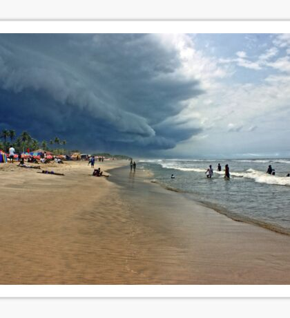 Storm clouds of an tropical hurricane bringing heavy rain over West Africa. Seen on a beach. Sticker