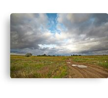 Country road and clouds Canvas Print