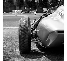 Classic racing #56 car sits in front of cricket match Photographic Print