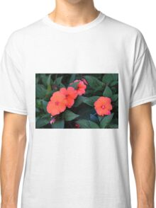 Beautiful red flowers and green leaves, natural background. Classic T-Shirt