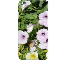 Colorful flowers and green leaves. iPhone Case/Skin