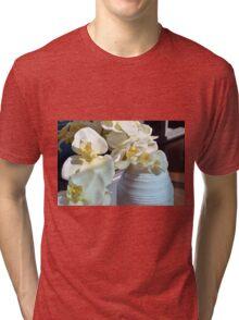 White flowers in the vase. Tri-blend T-Shirt