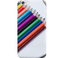 colored pencils and album closeup  iPhone Case/Skin