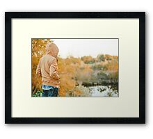 man looks in to woods Framed Print