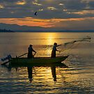 Casting nets in the sunset, Monte del Lago, Lago Trasimeno, Umbria, Italy by Andrew Jones