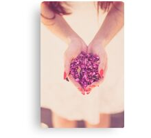 woman carrying flowers Canvas Print