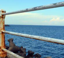 Grunge rusty handrail near the sea promenade. Sticker