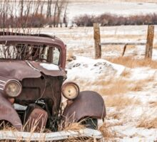 Rusty Antique Vehicle in a Field Covered with Snow Sticker