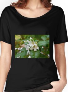 Macro on small beautiful white flowers on green leaves. Women's Relaxed Fit T-Shirt