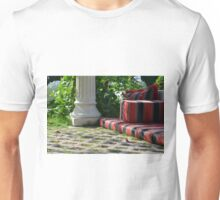Mattress in the park and white classical column next to green leaves. Unisex T-Shirt