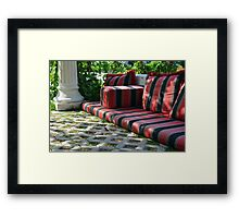 Mattress in the park and white classical column next to green leaves. Framed Print