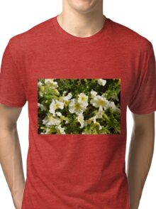 Beautiful yellow sunny flowers in the garden. Tri-blend T-Shirt