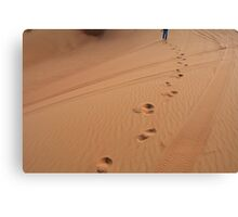 Man walking in the desert leaving footsteps in the sand. Canvas Print
