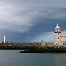 Lighthouse at Howth harbour. by heatherbyrne