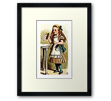 Alice About to Drink the Potion Framed Print