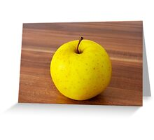 yellow apple on the table Greeting Card