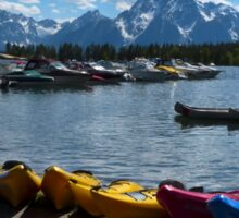 Red, Yellow and Blue Canoes on Shore Sticker