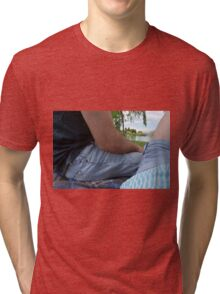 Couple on a date, sitting on a blanket in the park. Tri-blend T-Shirt