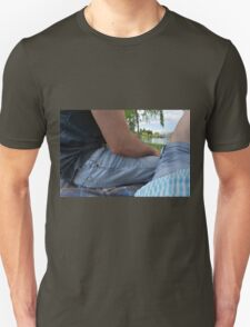 Couple on a date, sitting on a blanket in the park. Unisex T-Shirt