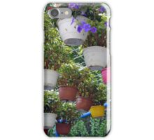 Many suspended flower pots in the park. iPhone Case/Skin