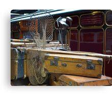 Travelling light? Vintage luggage on the railway platform. Canvas Print