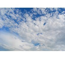 Blue sky with fluffy white clouds. Photographic Print