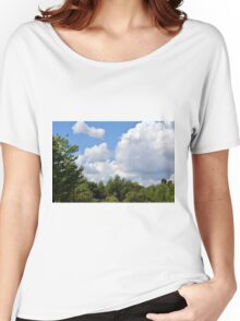Trees tops with green leaves in the park with blue sky and white fluffy clouds. Women's Relaxed Fit T-Shirt