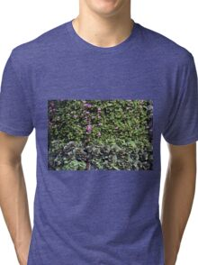 Green wall with pink flowers. Tri-blend T-Shirt