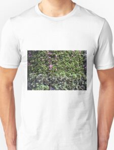 Green wall with pink flowers. Unisex T-Shirt