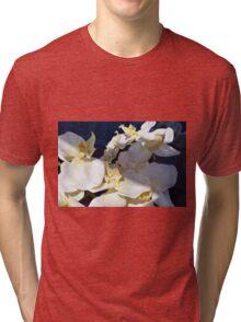 White plastic flowers. Tri-blend T-Shirt