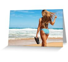 Sexy Young Woman in Blue Bikini Standing on the Beach Greeting Card